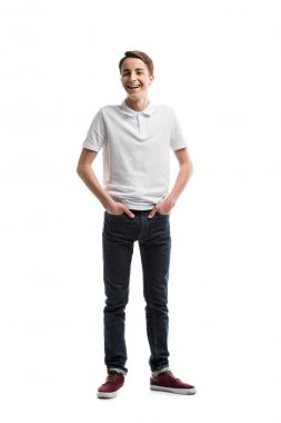 Happy caucasian teenager in casual clothing with hands in pockets isolated on white stock vector