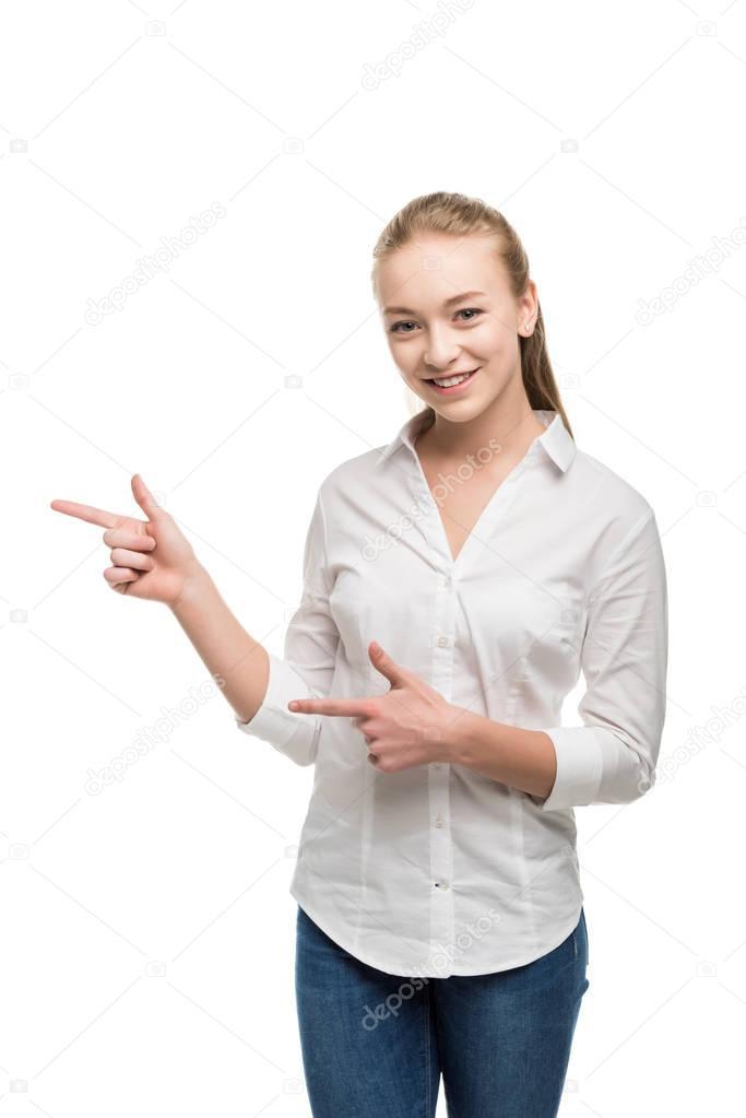 Caucasian teenage girl pointing away