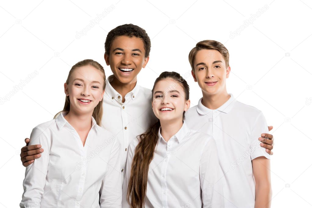 Cheerful multiethnic teenagers in white shirts