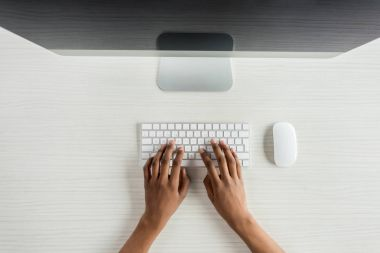 Cropped shot of student typing on keyboard while working on computer stock vector