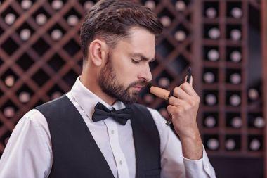 sommelier examining smell of wine cork