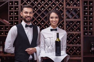 waiters with wine in cellar