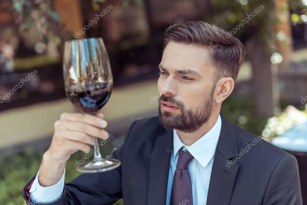 sommelier tasting wine