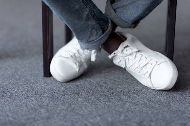 feet in stylish white shoes