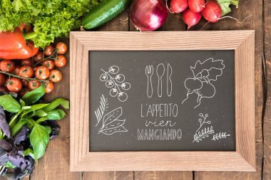 Overhead view of chalkboard with group of fresh vegetables for cooking breakfast. Enjoy your meal concept stock vector