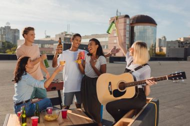 Friends having party on roof