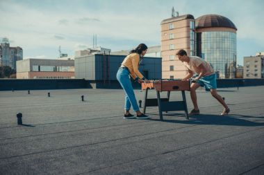 couple playing table football