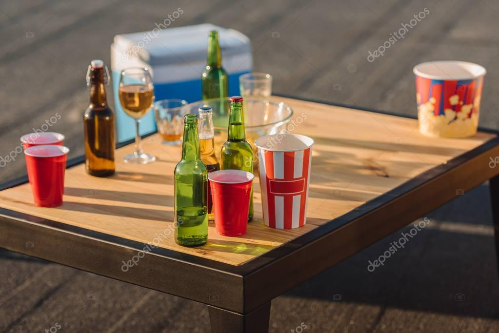 bottles, glasses and paper bowls for popcorn