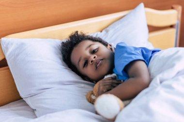 african american boy with teddy bear
