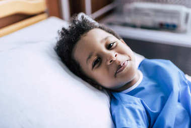 African american boy lying in bed