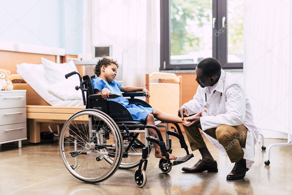 african american doctor and disabled patient