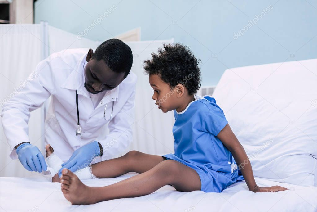 african american doctor taking care of patient
