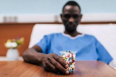 pills in plastic glass