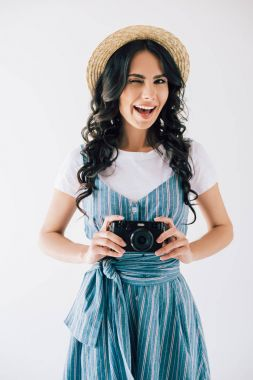 winking woman with photo camera in hands