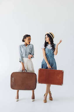 multiethnic women with luggage