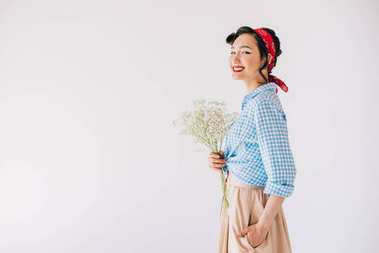 smiling asian woman with bouquet of flowers