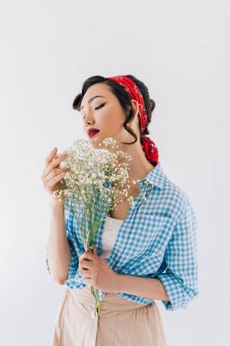 sensual asian woman with bouquet of flowers