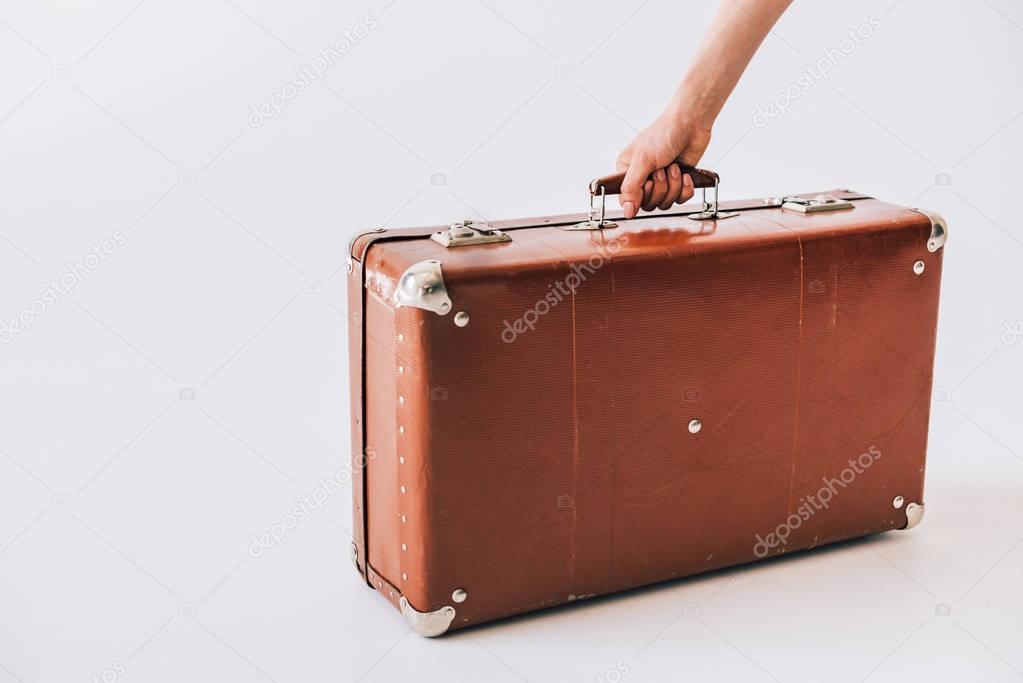 hand holding retro suitcase