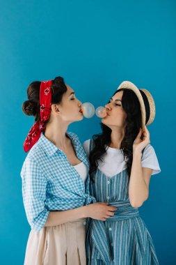 multicultural women blowing bubble gum