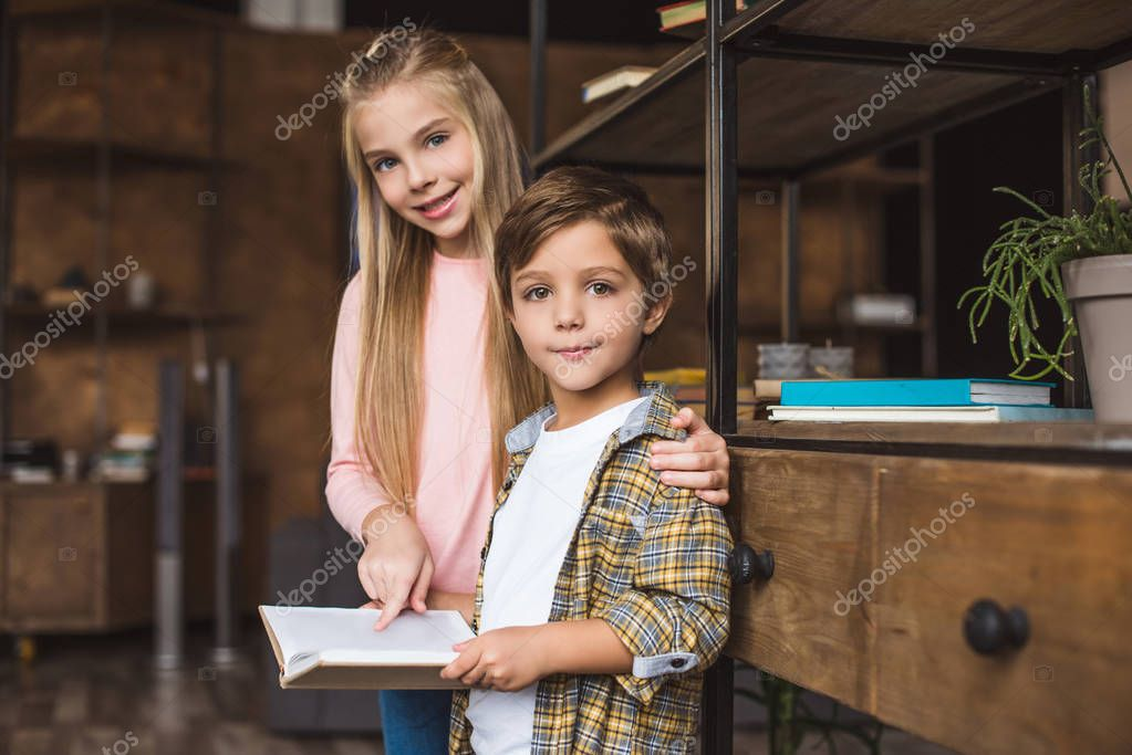 adorable kids with book