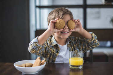little boy holding cookies