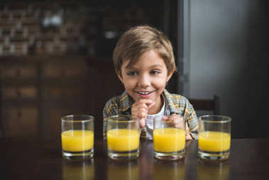 boy with glasses of juice