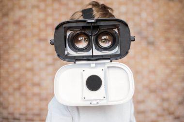 kid in virtual reality headset