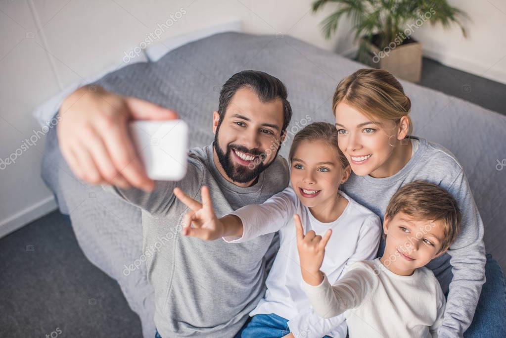 family taking selfie