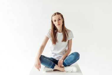 woman in blue jeans and white shirt