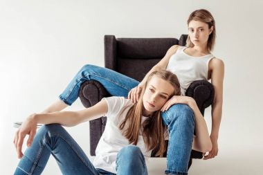 Lesbian couple on armchair