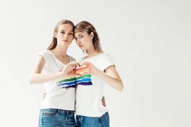 Female couple showing heart with hands