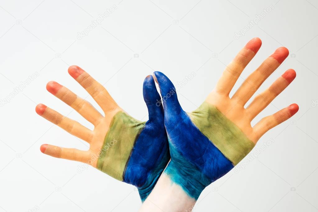 painted in rainbow hands
