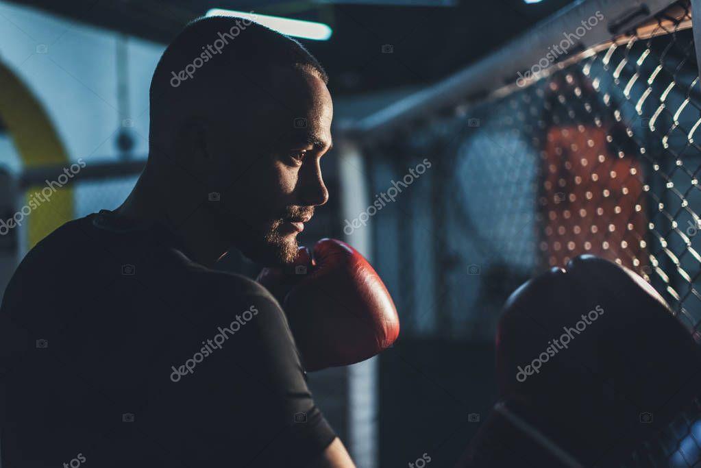 muscular sportsman in boxing gloves