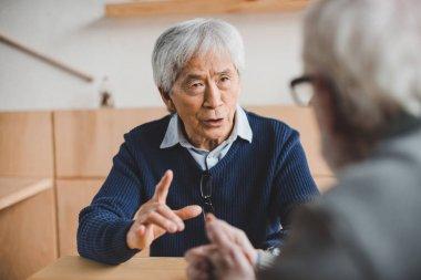 senior friends having discussion