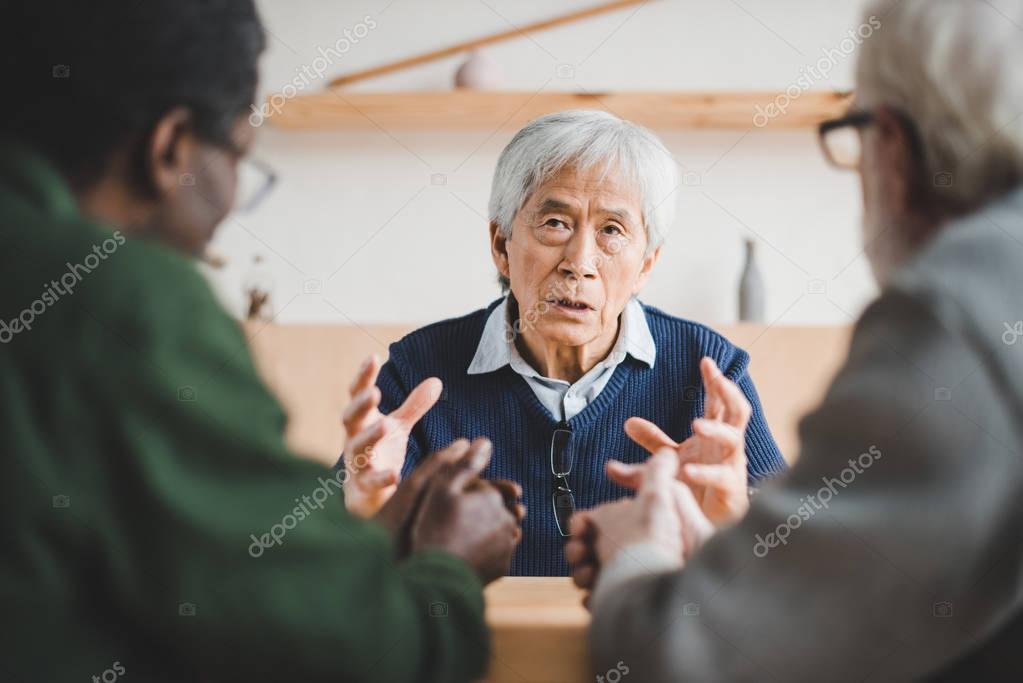 senior friends sharing stories