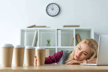 Tired businesswoman lying on table