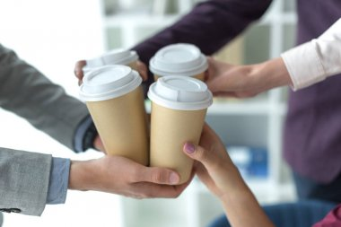 business partners clinking coffee cups