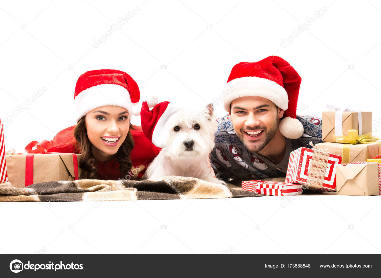 young couple with dog and christmas gifts stock photo