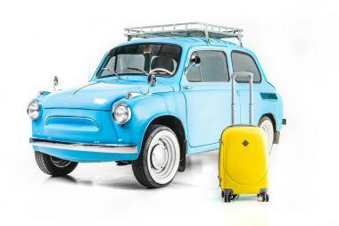 blue retro car with luggage