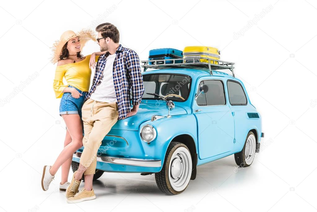 couple standing by car