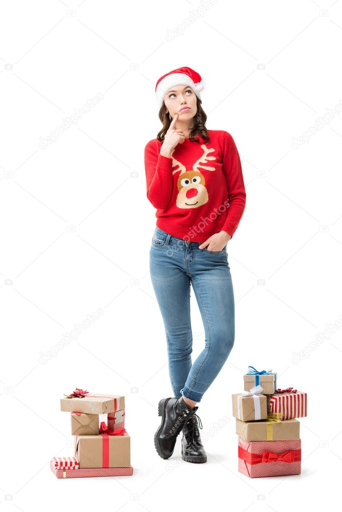 thoughtful woman with christmas gifts