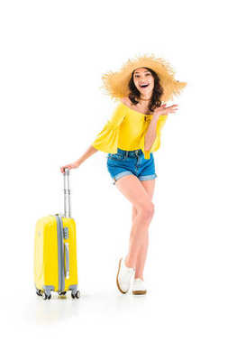 excited woman with luggage