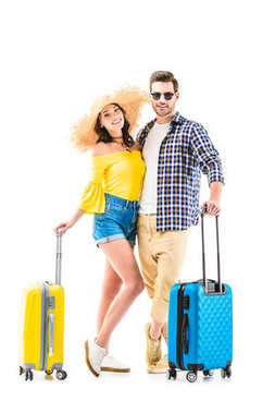Happy couple of tourists holding luggages and hugging each other isolated on white stock vector