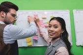 multiethnic businesspeople with task board