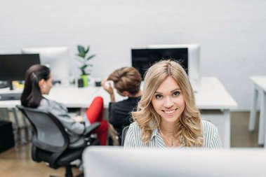young beautiful woman working with computer at modern office