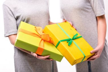 partial view of women with wrapped presents in hands