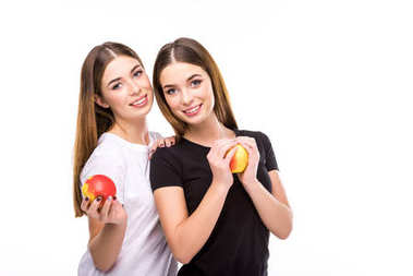 portrait of smiling twins with apples in hands looking at camera isolated on white