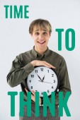 Photo Smiling businessman holding wall clock in hands on white with time to think inscription