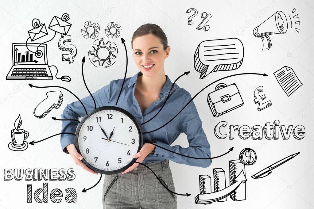 Smiling businesswoman holding wall clock in hands on white with creative business idea inscription and hand-drawn icons