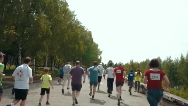 NIZHNY NOVGOROD, RUSSIAN FEDERATION - MAY 2015: Marathon, Street Runners In Spring Day. Charity Run, Amount of People Running In The Park